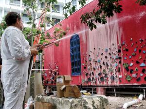 Artist Julian Schnabel at work on the Brickell Flatiron Sales and Design Gallery