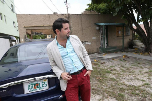 Local realtor and house flipper Jorge Artiles stands outside a property he and business partners recently purchased in Allapattah. CHARLES TRAINOR JR MIAMI HERALD STAFF