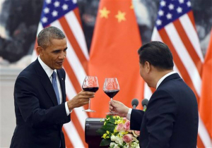 In this Nov. 12, 2014, file photo, President Barack Obama toasts with Chinese President Xi Jinping at a lunch banquet in the Great Hall of the People in Beijing. There could be some awkward undercurrents when the Chinese president is honored with a state dinner at the White House on Friday. The Obama's will honor a guest whose country has been accused of cyberspying, trampling on human rights and engaging in assertive military tactics. Greg Baker, File-Pool AP Photo